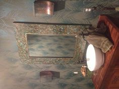 Peacock themed bathroom with wallpaper and mosaic mirror!