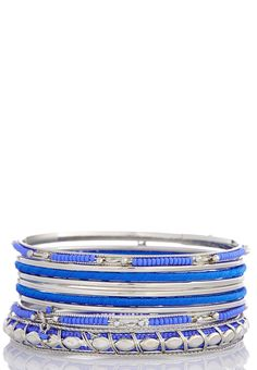 Brighten up your wrists with this mixed media bangle set. This shaky set looks great when paired with a fierce statement necklace.        9 piece set     2.75 in. diameter     Imported