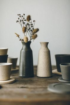 This beautiful slender carafe hand thrown by Jono Smart, can be paired with our matching Small Cup and Rest for a drop of sake or warming whiskey during an evening with friends, or simply to enjoy pouring milk into your morning tea/coffee. Alternatively, it can be used to display a delicate stem or two.