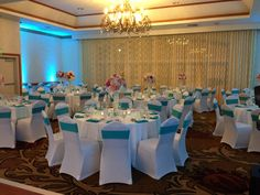 Chair covers & sashes available in house for your reception and included complimentary with our 2016 wedding promotion! #sandiegowedding #sandiegoweddingreception #carlsbadwedding #hgiweddings #weddingreception #ballroomdecor