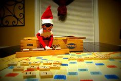 "elf playing scrabble; tiles read ""Santa says hi.""  HAHAHA!"