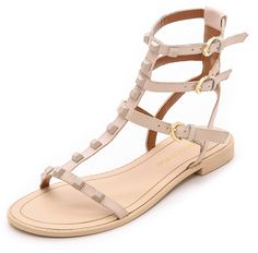 Rebecca Minkoff Georgina Studded Sandals $139 Tonal pyramid studs add an edgy element to these strappy leather Rebecca Minkoff sandals. Polished buckles secure the ankle straps. Flexible rubber sole.