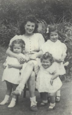 Annie-Rose Erdelyi was sadly murdered in the gas chamber in Auschwitz on February 13, 1943. Here's a photo of little baby Annie-Rose facing the camera standing next to her mother and 2 older sisters.