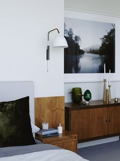 bedroom sideboard in set back area with large framed art over.  Wall lamps could be good for alpine