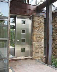 Fantastic stainless steel entry door. A great material because it won't shrink, rot or warp over time. I think the tiny windows make it look a bit like it belongs in a prison, but I like the materials!