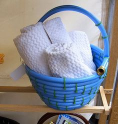 Cute housewarming/shower gift idea... Garden hose basket... I'd fill with garden tools. From: Upcycle Us