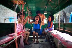 Joyful: Kids enjoying themselves inside a Jeepney in Cebu City, Philippines. Their smiles make me feel peaceful and joyful. I think this is pure happiness for them. (© Mac Kwan/National Geographic Traveler Photo Contest)