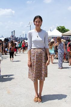 For an easy summer look, pair a floral midi skirt with a plain white long-sleeved tee.