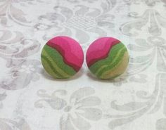 Super cute round green pink and tan swirl medium size button earrings.
