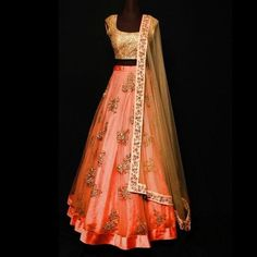 Rust color net Lehenga with golden sequin choli and dupatta. Zari work on Lehenga and zari work border on dupatta.