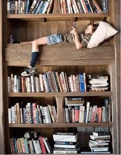 What a precious place to grow up!!  On a bookshelf!