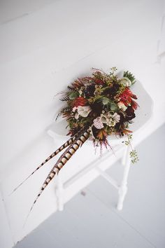 This boho bouquet recipe: protea, sea holly, leucadendron, grevalia, wax flower, and saracens