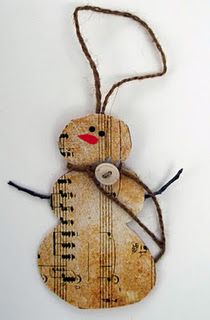 "I need to make these for my son and his band director. Now, to ""borrow"" some music from school today. hehe  I think I may use a wooden snowman (the flat ones they sell at the craft stores) and modpodge the music on it to make it more sturdy over the years. Use tea to age the music. LOVE!"