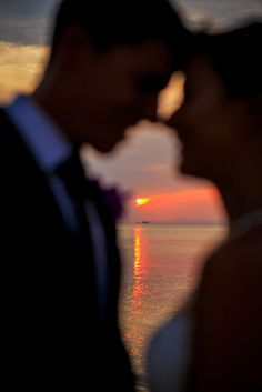 Khun Danai captures the perfect sunset moment.  Faraway Beach wedding, Koh Samui