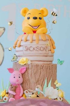 Take a look at the cute Pooh bear in a honey pot on a log tiered birthday cake at this Winnie the Pooh 1st birthday party See more party ideas and share yours at CatchMyParty.com #catchmyparty #partyideas #4favoritepartiesoftheweek #winniethepooh #winniethepoohparty #winniethepoohcake #boy1stbirthdayparty Boys 1st Birthday Party Ideas, Toy Story Birthday, 1st Boy Birthday, Birthday Party Decorations, Birthday Cake, Winnie The Pooh Cake, Winnie The Pooh Birthday, Fall Harvest Party, Bridal Shower Cakes