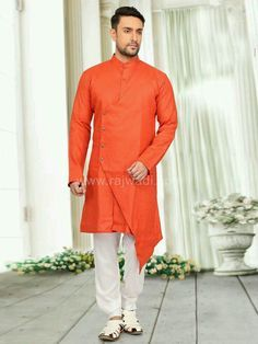 Stylish Tomato Red long sleeve kurta crafted on Linen fabric is available with contrast White Cotton fabric bottom. Fancy buttons are used to complete the look. Kurta Men, Boys Kurta, Indian Men Fashion, Mens Fashion, Fashion Suits, Fashion Wear, Pathani Kurta, Mens Pathani, Indian Groom Wear