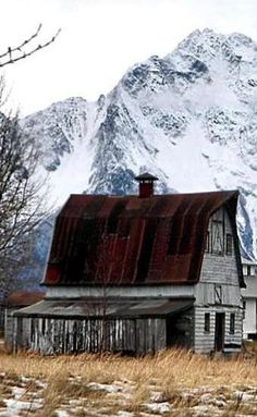 Barn Setting At Foot Of Mountains