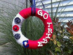 Cleveland Indians Go Tribe Wreath.   Yarn wrapped wreath with wood letters and fabric rosettes.