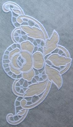Advanced Embroidery Designs. Cutwork Lace Rose Corner. Instructions on machine embroidered cutwork design.