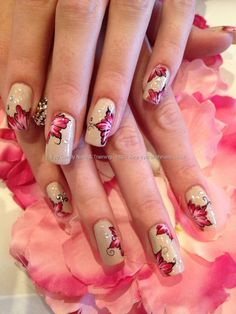 Freehand one stroke nail art.  Beige with pink and black flowers.