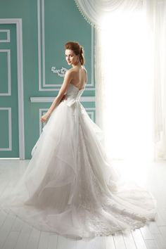 Love the flowyness of the back! Lace wedding dress Jasmine Bridal Collection Fall Style # gorgeous hair white curtain with pompoms and blue wall with white trim. Wedding Bridesmaid Dresses, White Wedding Dresses, Wedding Dress Styles, Designer Wedding Dresses, Bridal Dresses, Wedding Gowns, Lace Wedding, Dream Wedding, Jasmine Bridal
