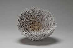 Hawaii-based artist Jacqueline Rush Lee works primarily with repurposed books to construct conceptual sculptures by stacking, sewing, and adhering the pages in unusual forms. At times the books are assembled into ambiguous or haphazard shapes that look anything like a book, while in other pieces the