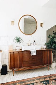 We're Obsessing Over This Modern Vintage Ohio Home mid century modern bathroom // wood stained vanity // round mirror // white tile floor Bohemian Bathroom, Bathroom Inspo, Bathroom Styling, Bathroom Interior Design, Bathroom Inspiration, Bathroom Ideas, Bathroom Organization, Budget Organization, Bathroom Shelves