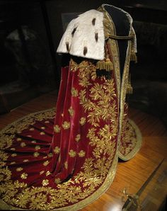 The mantle of the Austrian Empire  Design: Philipp von Stubenrauch (1784-1848) Execution: Johann Fritz, Master Gold Embroiderer Vienna, 1830 Red and white velvet, gold embroidery, sequins, ermine, white silk. 276 cm long