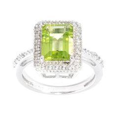 <li>Peridot and white topaz ring</li> <li>Sterling silver jewelry</li> <li><a href='http://www.overstock.com/downloads/pdf/2010_RingSizing.pdf'><span class='links'>Click here for ring sizing guide</span></a></li>