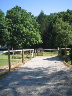 This track section was designed and built using geotextile material to eliminate mud. Using gravel on a track also helps keep the hoof healthy.