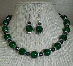 Check out this item in my Etsy shop https://www.etsy.com/listing/506873678/green-swirl-glass-beads-w-hematite