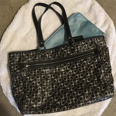 Authentic Coach diaper bag Black and grey signature c coach diaper bag with changing pad. Very good used condition. Easy to clean material. Coach Bags Travel Bags