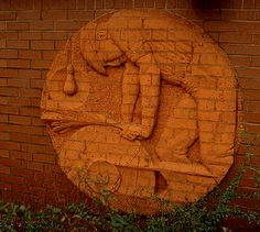 'The Grinder' (c.1980) brick roundel, now lost. Whitbread Brewery commission?