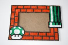 Photo frame Super Mario Bros Green Mushroom 1 up hama perler beads by DecorarteLeon Melty Bead Patterns, Pearler Bead Patterns, Perler Patterns, Beading Patterns, Hama Beads Mario, Diy Perler Beads, Pixel Beads, Fuse Beads, Nerd Crafts