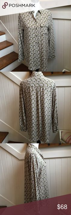 """Equipment Floral Top Like New Green and pink floral printed Equipment silk with single flap pocket at bust and button closures at center front. Bust: 38"""" Waist: 38"""" Length: 28"""" Condition: excellent no signs of wear. Like New Fabric: 100% Silk Equipment Tops"""