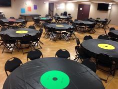 """""""Top 40"""" party. Tables are vinyl records. (Black plastic table cloth, poster board circle, Google top 40 hits from the year of the birthday boy/girl and make record labels) #40th #birthday #party"""