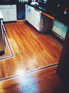 Strip White Oak Kitchen. Done by Todd's Hardwood Flooring.