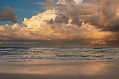 A clear day at the beach changes dramatically as a storm passes on the horizon. #clouds #storm #beach #sea #ocean #wallart #sunset