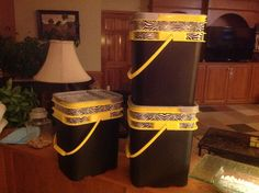 Cat litter buckets, spray painted black, and decorated with zebra striped duct tape. Great stackable toy containers for blocks, etc.