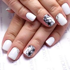 Studded White and Black Nail Art. Most of you own black and white formal dress and in that case, you would definitely need this kind of black and white nail art.