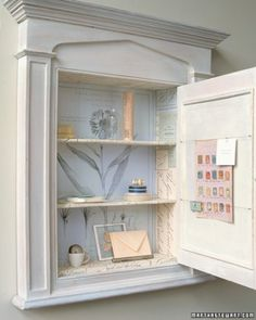 Give a cabinet or shelves a sense of surprise by lining them with old documents, illustrations, sheet music, or postcards