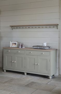 Inspiration for a dining room sideboard/buffet (but not this color.) This: Neptune Dining Sideboard. (Six feet.)