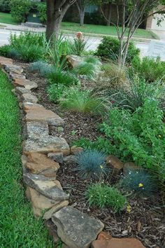 Pick the flatest side of the rock when landscaping edging Front yard- driveway and/or front planter.
