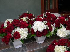 beautiful short centerpieces...could possibly use these for the ceremony aisle and then as centerpieces for the reception