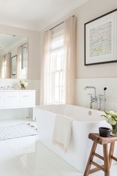 The elegant faucets in the master bath are from Waterworks and the tiles are white Thassos marble. Simonpietri added a subtle dose of color through the decor | archdigest.com