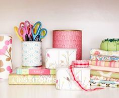 DIY:Turn coffee tins, soup cans, and powdered drink tubs into pretty storage containers by covering them with decorative papers.