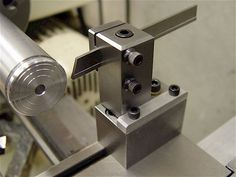 Adapted the Taig T-bar cutoff tool to work on the The blade is positioned… Benchtop Milling Machine, Cnc Lathe Machine, Diy Lathe, Lathe Tools, Homemade Lathe, Homemade Tools, Small Metal Lathe, Square Tool, Lathe Accessories