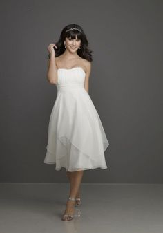 This affordable and lovely Empire Line wedding dress is handkerchief overlay Chiffon and has a Strapless Sweetheart Neckline, and would be ideal for your garden wedding, or vow renewal ceremony.