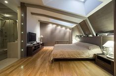 Modern loft conversion creating a stunning double bedroom with large sky lights.