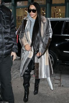 Early on Valentine's Day: Kim Kardashian wore her favorite striped fur coat as she stepped out in New York City on Tuesday